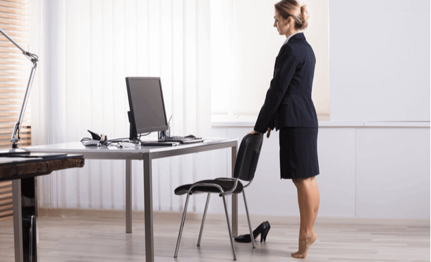 Standing-tip-toe-on-desk-as-exercise